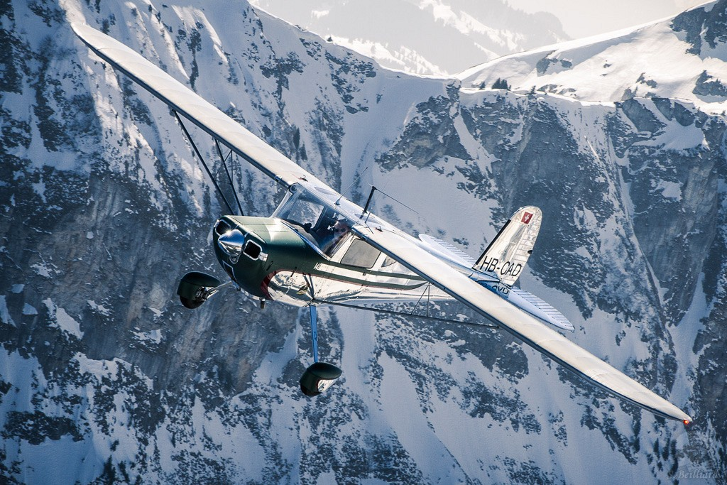 Cessna 140 over the Alps